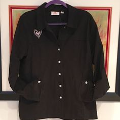 Quacker Factory shirt- jacket w/ heart Large NWOT This Quacker Factory shirt/ jacket is a heavy cotton/ Spandex blend in black with a pink & white embroidered heart design.  It's a size Large, with slash pockets and nice shaping.  It has rhinestone buttons, however, the second one from the top is missing as you can see in the photo.  You can remove either the top or the bottom button & use it as a replacement.  This is new without tags, the plastic tag holder is intact at the neck. Quacker…