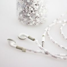 Beaded earphones. Less tangling and they won't get mixed up with anyone else's. In English and Swedish.