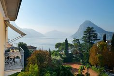 Travel Inspiration for Switzerland - five-star living, exquisite dining and lake side views are something you absolutely revel in then the Grand Hotel Villa Castagnola in Switzerland is a bucket-list must for you
