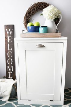 This custom tilt-out trash cabinet is awesome for hiding ugly trash cans and can be customized to match your kitchen!