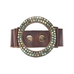 """An open circle shaped focal covered with African Turquoise attached to a wide dark brown leather band with three snaps. Bracelet length is adjustable from 6 1/2"""" to 7 1/2"""" by Rebel Designs available at #kewel"""