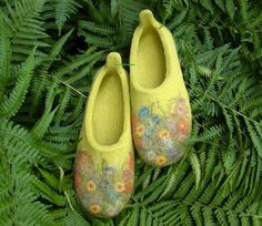 Handmade felted wool slippers with a whimsical floral design...