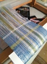 On the rigid heddle  loom this weekend, a light pastelly summer scarf.  Bamboo, rayon, cotton, and a little sparkle.