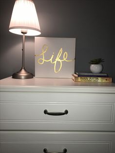 to add personality to a dresser or chest or drawers, use a lamp and canvas art (for height) and put a pile of a few books (for slightly less height compared to the lamp & canvas) you can also put plants or succulents to spice up your pile of books:)