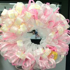 """""""Baby Girl, The Center of My World"""" is approx 22 inches with white deco mesh base, pink deco mesh tubing, sheer pink with ruffle edge ribbon, baby footprints & binkies printed pnk/wht/yellow ribbon & bow, and baby girl rubber ducky. $53... Cute-age. For a gift. For a baby's nursery. For a baby shower. CHECK OUT MY FB PAGE: Empire Wreath Co! PINNERS: please leave this cement with the photo. Thanks!!!"""