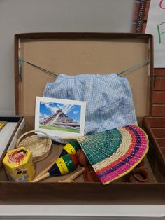 Grandma's suitcase made from recycled materials with traditional Latinamerican items inside. Maleta de abuelita echa de materiales reciclados con articulos Latinoamericanos adentro.