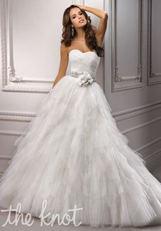 Gown features beading and corset bodice.