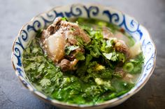 Hawaiian Oxtail Soup ~ Hawaiian oxtail soup with oxtails, slowly cooked to produce their own broth, with ginger, anise, orange peel, peanuts, chili, mustard greens, onions, and cilantro. ~ SimplyRecipes.com