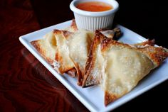 Baked Crab Rangoon Recipe | Hmmmm...this might be the one that I try today. The sauce sounds delish!