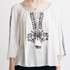 Peasant Blouse This blouse is so cute and is embroidered on the front and the arms! Forever 21 Tops Blouses