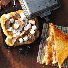 Milky Way Pudgy Pie Recipe -My favorite pudgy pies have Milky Way candy bars, graham cracker crumbs and marshmallows. So irresistible! And buttered bread is a must. —Ashlan Potts Ontario, Canada