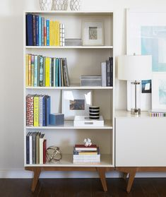 The Art of Arranging: 6 Tips on Creating Stylish Shelf Displays - Photo 3 of 6 - Whether it's a tall book, vase, or frame, it is important to include larger items so that they can act as the anchor to a specific grouping.