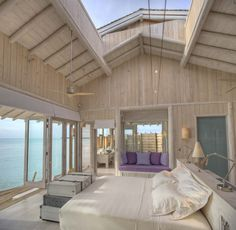 Inside your over water villa at Soneva Jani, Maldives. You can even open the roof. Just picture yourself lying there at night watching the stars holding the love of your life tightly in your arms
