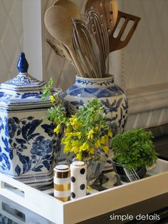 blue and white pottery as utensil holder, kate spade salt and pepper, herbs planted in tea cup, mixing pattern