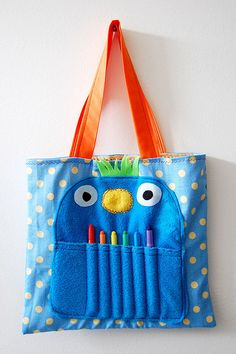 Adorable!  Tote bag with a critter sewn on the front - the teeth are pencil or crayon holders.  Great idea for a car activity bag!