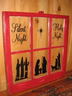 Silent Night red antique window with nativity scene.