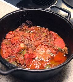 Swiss Steak  INGREDIENTS  •	8 cube steaks, chopped  •	Salt  •	Pepper  •	Flour (enough to cover steaks)  •	Peanut oil  •	2 bell peppers (more, if desired)  •	2 sticks of celery  •	1 large onion  •	6-7 cloves of garlic  •	20 oz. can of whole or crushed tomatoes