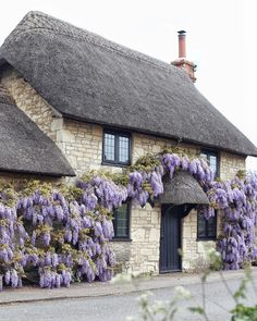 Beautiful cottage bedecked with Blooming Wisteria in Somerset, England. Stone Cottages, Cabins And Cottages, Stone Houses, Cute Cottage, Cottage Style, Storybook Homes, English Country Cottages, English Cottage Exterior, Thatched Roof
