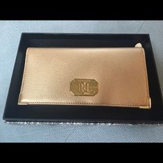 Acadia Lea Slim Wallet in Gold Rush This stunning gold Ralph Lauren Wallet has never been used and is still attached in its original box with sales tag in an inner pocket. Ralph Lauren Bags Wallets