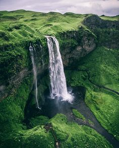 Seljalandsfoss waterfall, Iceland. Seljalandsfoss is one of the most popular waterfalls and natural wonders in Iceland. The waterfall drops 60 meters and is part of the Seljalands River that has its origin in the volcano glacier Eyjafjallajökull. One of the interesting things about this waterfall is that visitors can walk behind it into a small cave. Photo by liam_tansey via Instagram #amitrips #travel #waterfall #iceland