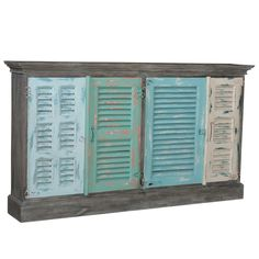 Four shutter doors that look as though they may have once protected Victorian windows from the battering force of hurricanes long past Waterfront Aqua Shutter Credenza - coastal cottage Coastal Style, Interior Shutters, Victorian Windows, Coastal, Painted Sideboard, Board And Batten Shutters, Coastal Cottage, Shutters Exterior, Cottage Shutters