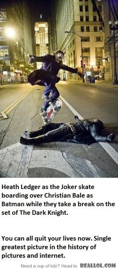 Heather Ledger as the Joker skates over Christian Bale in full Batman gear while on a break during the filming of  The Dark Night.