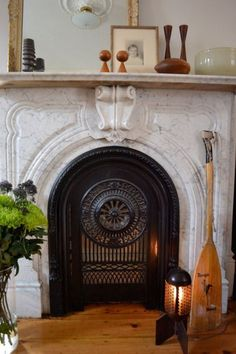 Fireplace - From Andy and Andrew's Vintage Modern House Tour Apartment Therapy Fireplace Fender, Fireplace Doors, Fireplace Mantle, Fireplace Grate, Fireplace Ideas, Fire Doors, Marble Fireplaces, French Country Style, Old Houses