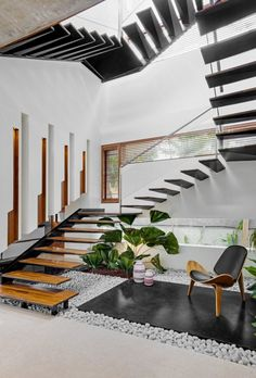 The Bungalow Has Striking Inclined Wall Which Adds Dynamism | Crest Architects - The Architects Diary Cleaning White Walls, House Architecture Styles, Interior Decorating, Interior Design, Interior Ideas, Staircase Design, Staircase Ideas, Floating Wall, Bathroom Design Small