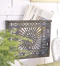 Make Metal Newspaper Racks Old, ornate metal heating vents are too pretty to leave sitting collecting dust, so press them into service as nifty wall-mounted newspaper racks. Attach a vent to the wall with screws for instant storage. Vintage Furniture, Diy Furniture, Furniture Refinishing, Refurbished Furniture, Repurposed Furniture, Magazine Holders, Magazine Racks, Magazine Storage, Metal Magazine