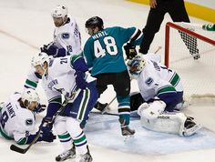 San Jose Sharks rookie forward Tomas Hertl finds himself in a sea of Vancouver Canucks (Oct. 3, 2013).