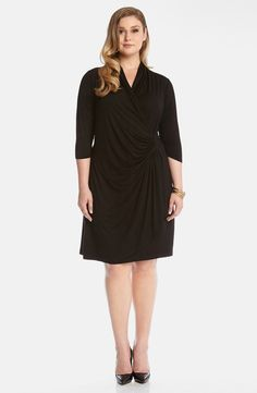 Create compelling curves in a flattering stretch-jersey dress styled with a high, surplice neckline, three-quarter sleeves and a cascading skirt panel.