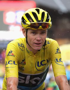 Chris Froome of Great Britain and Team Sky (yellow jersey) looks on in the rain as he finished stage twenty of the 2016 Le Tour de France, from Megeve to Morzine on July 23, 2016 in Megeve, France.