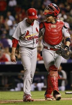 starting pitcher Joe Kelly is checked on by catcher Yadier Molina after Kelly retired the Colorado Rockies in the fifth inning...Cards won the game 11-4.  9-17-13
