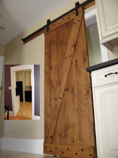 How to turn unfinished hardwood into a sliding barn door! Love this! Thanks @MyFixitUpLife Family Family!