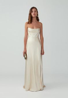 A formal maxi dress featuring thin straps, a draped neckline, a defined waist, and a full skirt with a side split and slight train. It has an invisible zipper and a hook and eye closure. Neutral Bridesmaid Dresses, Grad Dresses, Formal Dresses, Bridesmaid Gowns, Corset Dresses, Simple Dresses, Pretty Dresses, Beautiful Dresses, Romantic Dresses
