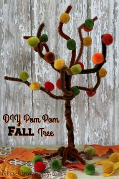 Check out this Fall Craft for an Easy Pom Pom Fall Tree! So cute and it is fun, easy and cheap to make!  http://reusegrowenjoy.com/fall-craft-easy-pom-pom-fall-tree/