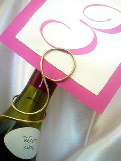 Wine Bottle Number Sign Holder for Reception by HomesAndWeddings, $150.00