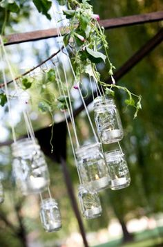Mason jar chandelier in backyard wedding.