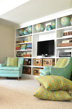 Globes, Maps, Turquoise, Aqua, Yellow Retro, Wall of cabinets surrounding the TV. This is what most people do. Unfortunately, the TV is made the MOST obvious when perched in cabinetry painted white.