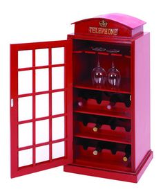 i would totally get this if it was cheaper! Bring charming appeal to your pantry or sideboard with this whimsical wood wine rack, showcasing a London phone booth silhouette and stemware storage.