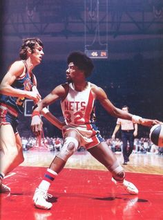 barondavisneckbeard:  Future teammates Bobby Jones and Julius Erving