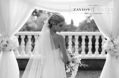 What a beautiful bride! with a stunning white bridal bouquet, orchids, white roses, white orchids, brides dream. white floral arch, flower arch, best floral arch. wedding day, best wedding ever, royal wedding. floral tie backs