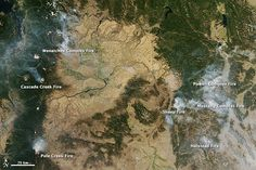 Satellite images show wildfires burning across the U.S. west in September, 2012.