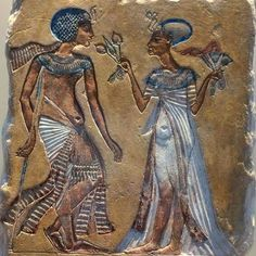 Tutankhamun with his wife Ankhesenamun.She is giving him lotus flowers to scent.