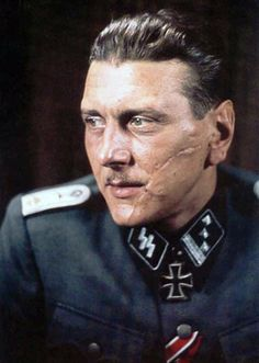Handsome and dashing Austrian Otto Skorzeny. The Americans called him 'Scarface' because of his prominent scar, which he received in a fencing accident as a university student in Vienna.