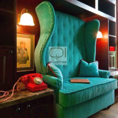 Mad hatter high backed blue chair