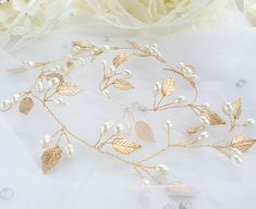 Check out this item in my Etsy shop https://www.etsy.com/listing/604348797/vine-leaf-bridal-hair-accessory-pearl