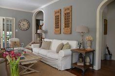 Gray walls, sisal carpet, white and cream upholstery