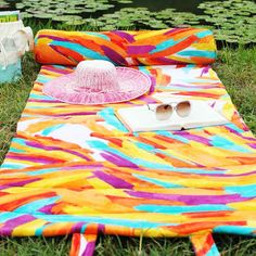 Stop trying to stuff that oversized beach towel in your bag and make an easy roll-up version to sling over your shoulder instead.   | 10 Perfect DIY Projects For The Beach