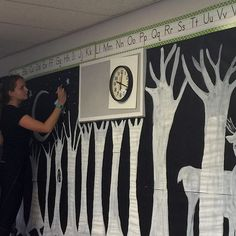My folktale fairytale themed classroom is coming together!  Becca created an enchanted forest using black paper and white paint to give a chalkboard affect. #teachers #teachersfollowteachers #tpt #color #chalkboard #forest #art #bulletinboard #trees #pain